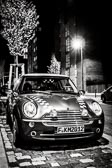 Mini Cooper under a streetlight